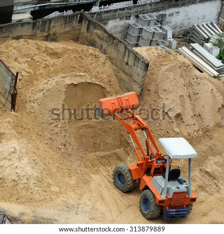 Backhoe loader in the building site - stock photo