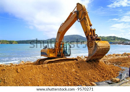 backhoe moving soil - stock photo