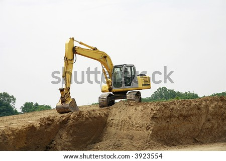 Backhoe on a Pile of Dirt - stock photo