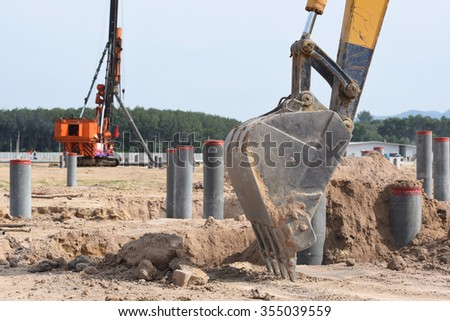 Backhoe standby waiting excavation of soil piling work - stock photo