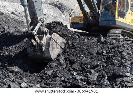 backhoe work in coalmine - stock photo