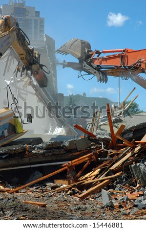 backhoes tearing down walls - stock photo