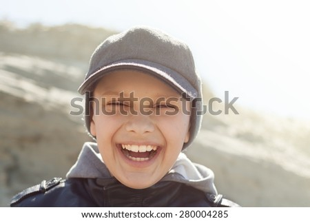 backlight child close up happy smile portrait outdoor