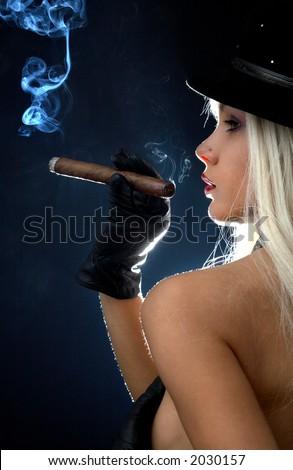 backlight image of topless girl smoking cigar - stock photo