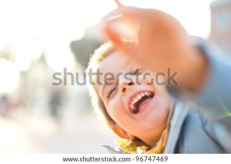 Backlight kid portrait. - stock photo