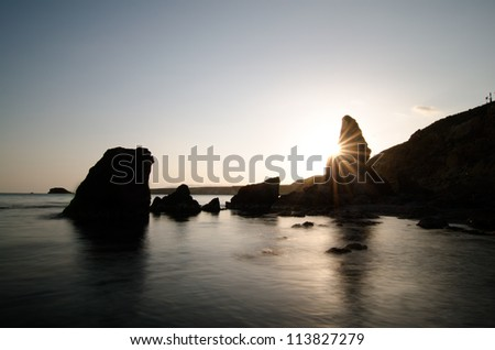 backlight on a beach in Murcia (Spain) at sunset of a summer day
