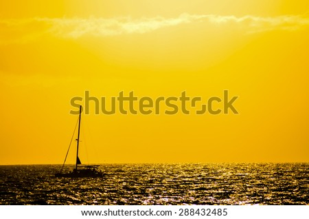 Backlight Picture of a Silhouette Boat in the Ocean