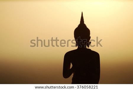 Backlight silhouette of Buddha statues in the temple - stock photo