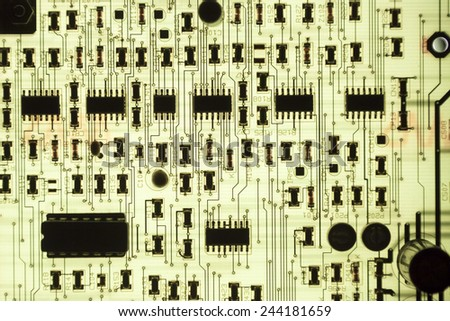 backlighted PCB board with small components - stock photo