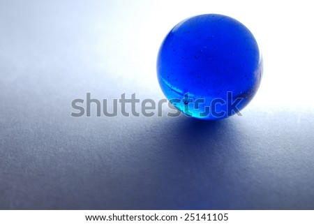 Backlit blue marble on white paper - stock photo