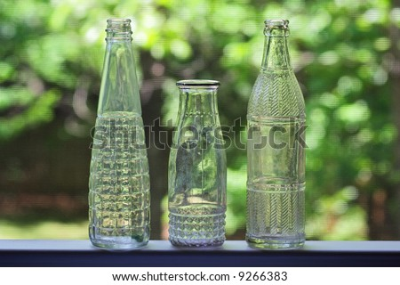 Backlit bottles on window sill