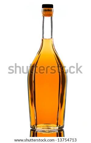 Backlit brandy bottle isolated over white background - stock photo
