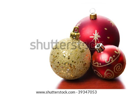Backlit Christmas baubles on a wooden table