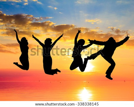 Backlit Group Jumping over Sunset