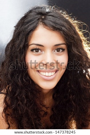Backlit portrait of an attractive woman - stock photo