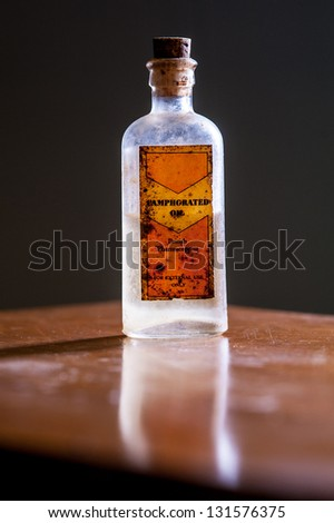 backlit vintage UK medicine bottle from fifties - medicine concept - stock photo
