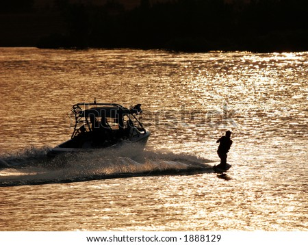 Backlit wakeboarder. - stock photo
