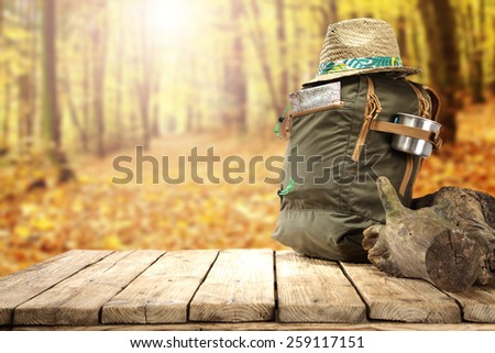 backpack and table of free space for you in forest  - stock photo