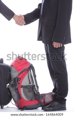 Backpack businessman talk with partner in the airport - stock photo