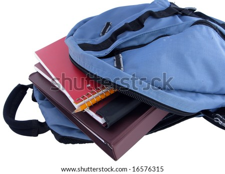 Backpack filled with school supplies - stock photo