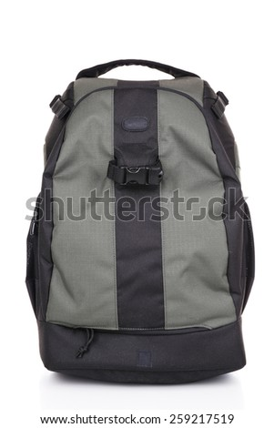 Backpack of photographer isolated on white - stock photo