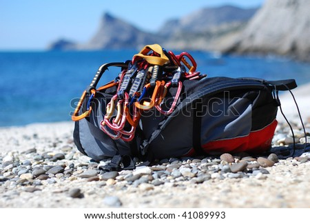 Backpack of the rock-climber with quickdraw - stock photo