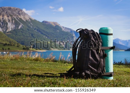 backpack on the mountain background - stock photo