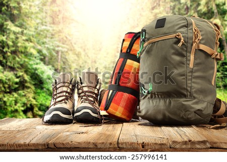 backpack shoes and sunny forest  - stock photo
