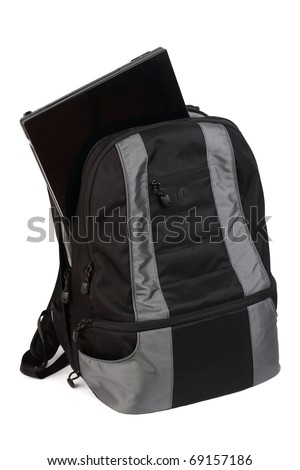 Backpack with a laptop inside isolated on white background - stock photo