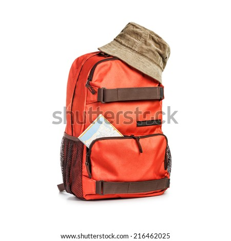 Backpack with hat and map isolated on white background. Tourism and travel themes. Clipping path - stock photo