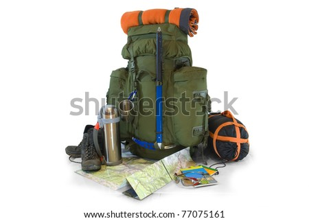 Backpack with tourist equipment - isolated on white - stock photo