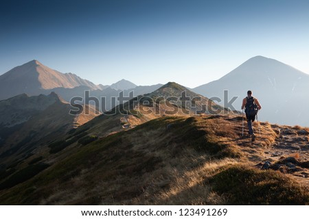 Backpacker at Ornak Peak in Tatra Mountains, Poland - stock photo