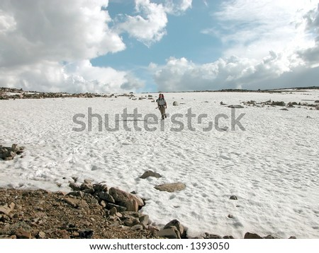 Backpacker escaping a thunderstorm on Froze-to-Death Plateau. - stock photo