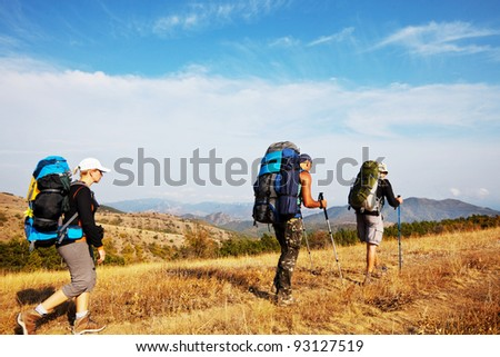 backpacker  in mountains - stock photo