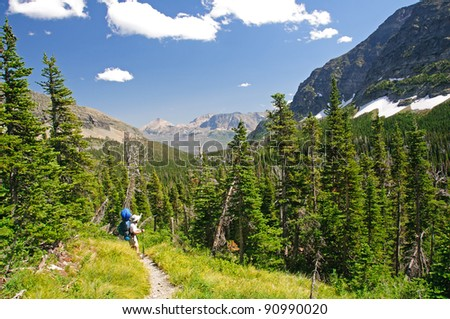 Backpacker in the Lake Okatomi Trail In Glacier National Park - stock photo