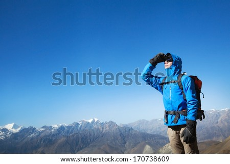 backpacker in the mountains - stock photo