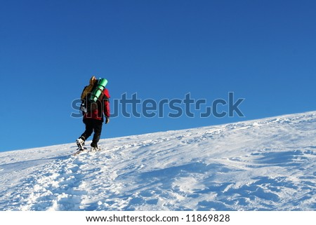 Backpacker  in the winter mountain