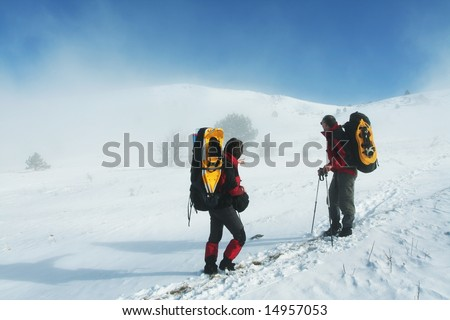 Backpacker in winter mountain