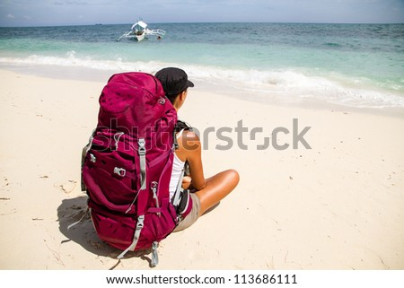 backpacker on beach - stock photo