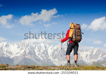 Backpacker on the trail high in the mountains - stock photo