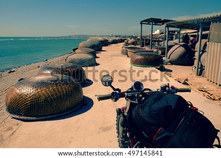 Backpacker trip to adventure Vietnam beach by motorcycle in summertime, Binh Thuan fishing village with group of coracle along the way, motorbike stop to relax