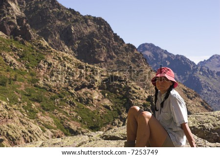 Backpacker woman resting before going high up the mountain - stock photo