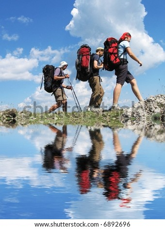 Backpackers group going  in mountain - stock photo