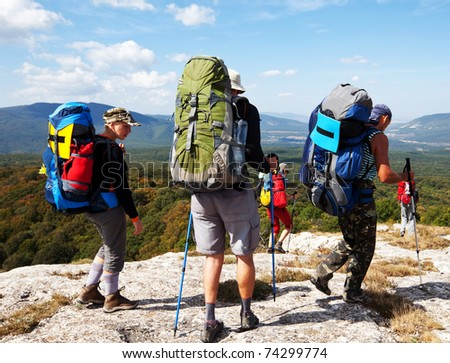 backpackers  in mountains - stock photo