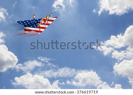 Backpackers on paper american airplane - stock photo