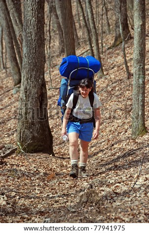 Backpacking up the Wolf Creek Trail in the Great Smoky Mountains - stock photo
