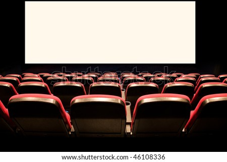 Backs of empty red seats in a movie theater with a white screen - stock photo