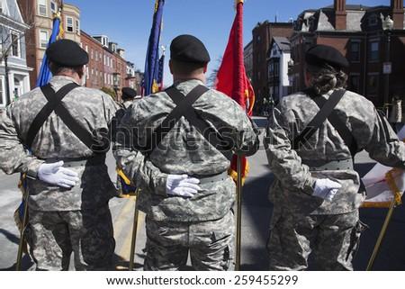 Backs of US Military Honor Guard at ease, St. Patrick's Day Parade, 2014, South Boston, Massachusetts, USA, 03.16.2014 - stock photo