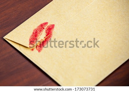 backside  envelope with  lipstick kiss - stock photo