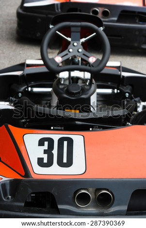 Backside of an racing go kart with focus on participant number 30 - stock photo